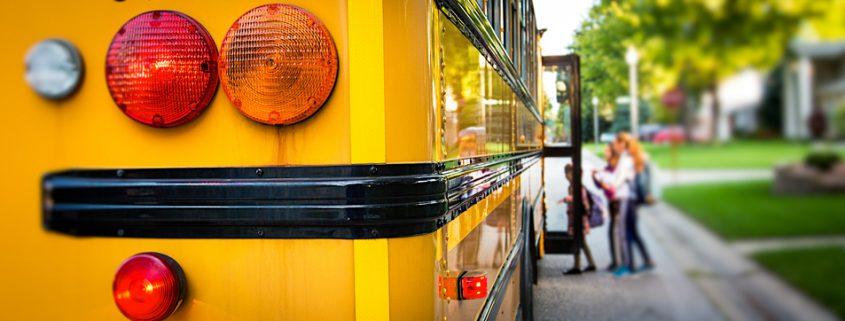 School bus with kids boarding